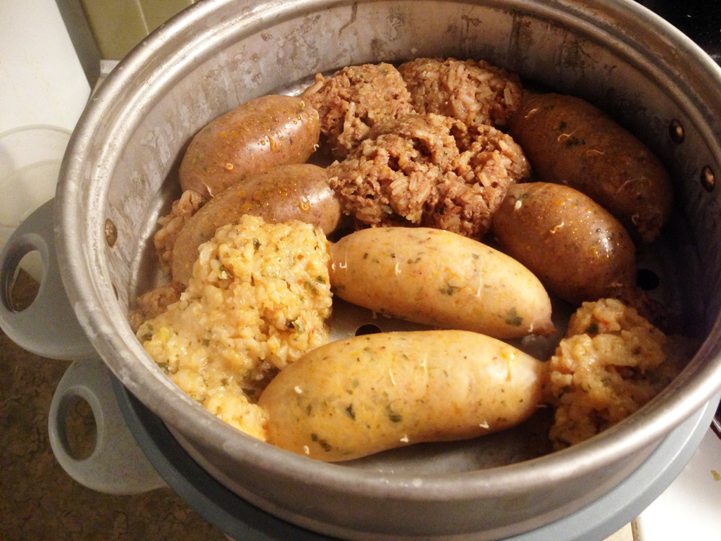 baked the boudin pretty well though, and the only reason they burst ...