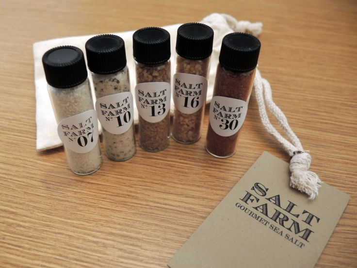 From Left to Right: Grey Salt, Black Truffle Salt, Ghost Chili Pepper Salt, Roasted Garlic Salt, and Applewood Bacon Salt.