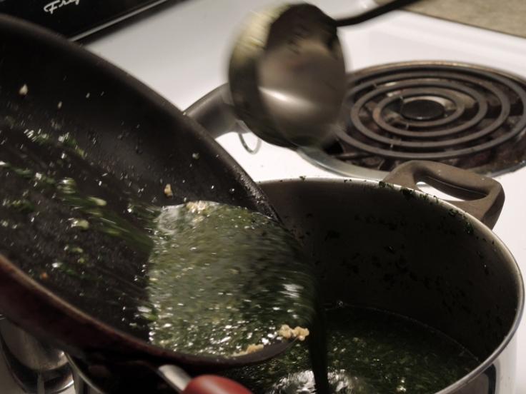 Pouring Molokhia over Sateed Garlic