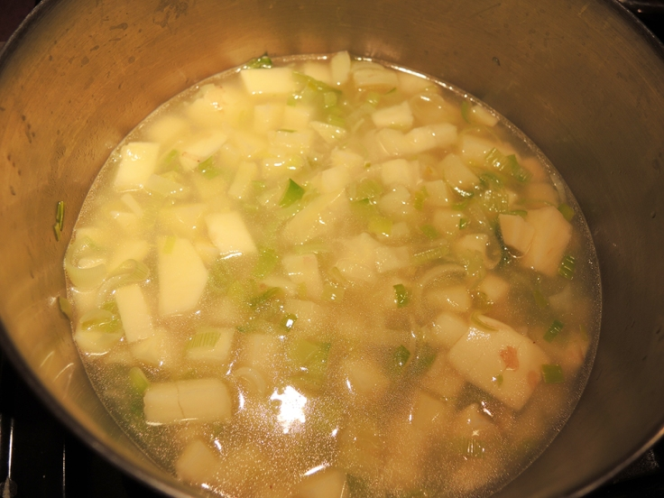 Potatoes added to Leeks and Broth for Man Fuel's Potato Leek Soup