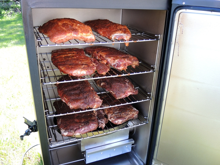 Man Fuel Food Blog - Dead Rooster Co Black Gold Rub Review - Ribs in Smoker