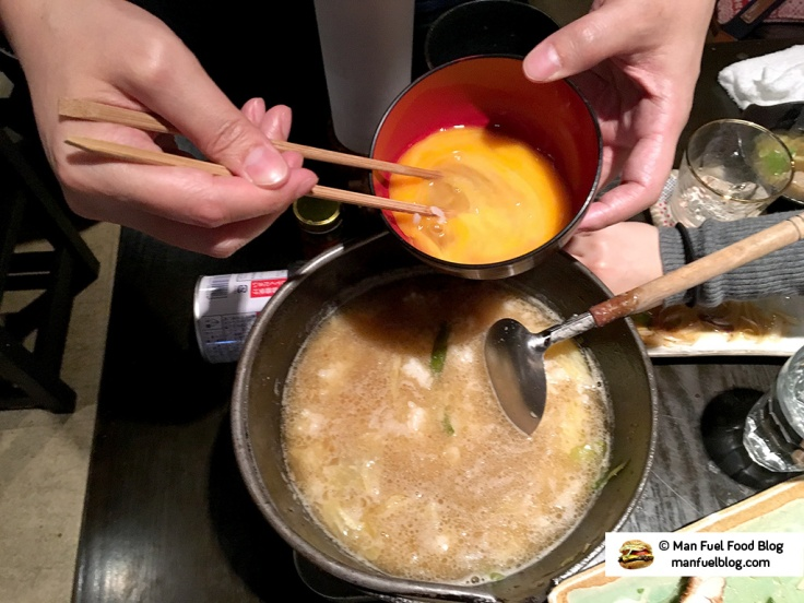 Man Fuel Food Blog - Kurara - Koenji, Japan - Adding Egg to Hot Pot